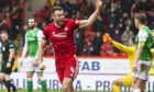 Andy Considine celebrates his goal against Hibs at Pittodrie a year ago.