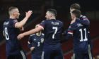 Scotland's John McGinn (centre) celebrates with Scott McTominay (left) after scoring their side's second goal of the game during the FIFA 2022 World Cup qualifying match at Hampden Park, Glasgow. Picture date: Thursday March 25, 2021. PA Photo. See PA story SOCCER Scotland. Photo credit should read: Jane Barlow/PA Wire.  RESTRICTIONS: Use subject to restrictions. Editorial use only. Commercial use only with prior written consent of the Scottish FA. Call +44 (0)1158 447447 for further information.