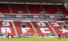 A general view of the empty stands during the Scottish Premiership match between Aberdeen and Rangers at Pittodrie in August.