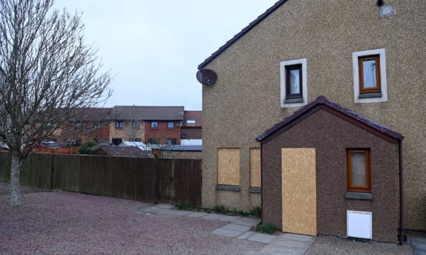 The body of a woman was found in the house which has now been boarded up.