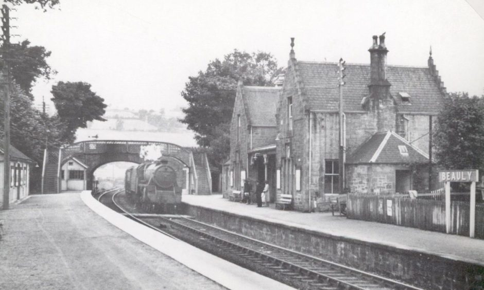 A steam locomotive arriving at Beauly station, which had one of the private waiting rooms on the Highland Railway. Provided by the Highland Railway Society.