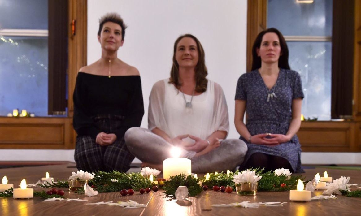 Sarah Gear, Julia Morton and Kate Butterfield take part in a yoga class.