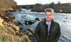 Mark Bilsby, chief executive of Atlantic Salmon Trust, on the River Dee near Banchory.