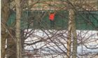 Children were spotted dangerously climbing on the bridge over the River Don at Port Elphinstone on February 21