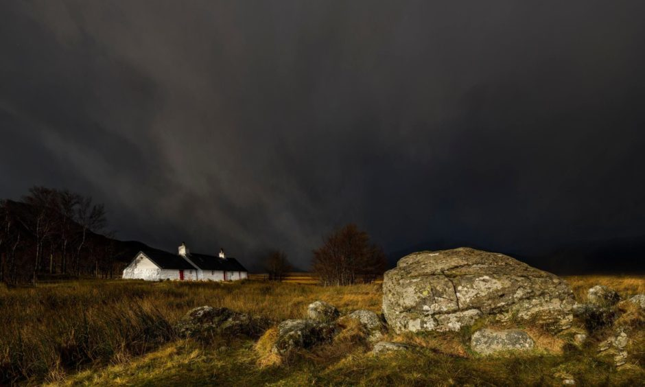 Mandatory Credit: Photo by Robert Seitz/imageBROKER/Shutterstock (10090736a) Black Rock Cottage in front of thunderstorm with Glen Coe, Rannoch Moor, west Highlands, Scotland, United Kingdom, in the background VARIOUS