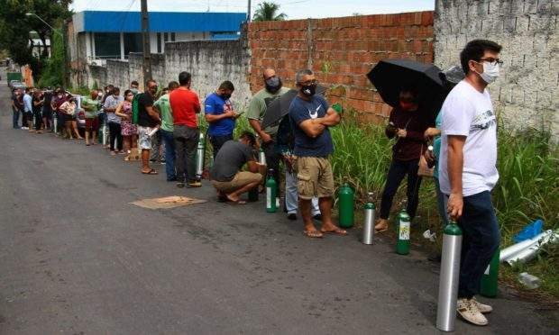 Family members of patients hospitalized with Covid-19 line up with empty oxygen tanks in an attempt to refill them, outside the Nitron da Amazonia company, in Manaus, Brazil.