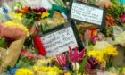 Flowers left at a vigil for Sarah Everard after her murder