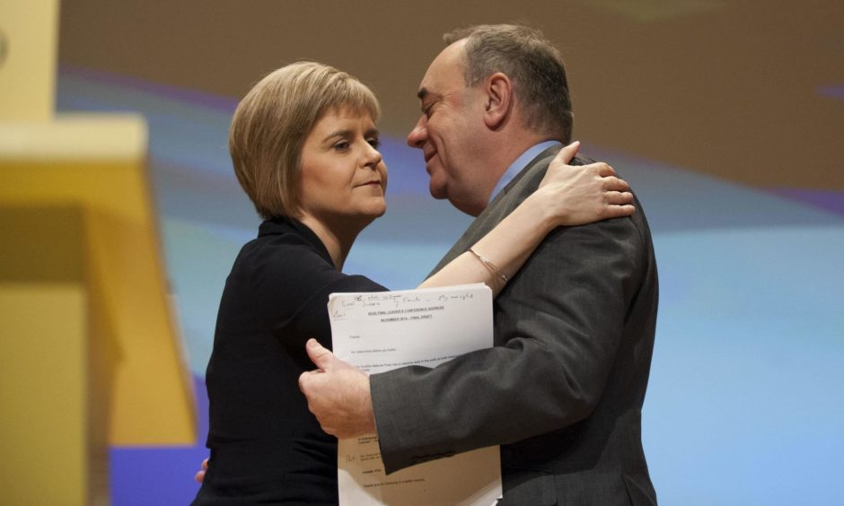 Mandatory Credit: Photo by Jane Barlow/Shutterstock (4244436j) Nicola Sturgeon and Alex Salmond 80th SNP Annual National Conference, Perth, Scotland, Britain - 14 Nov 2014 Scotland's First Minister Alex Salmond and former party leader with new party leader and soon to be First Minister Nicola Sturgeon. Nicola Sturgeon was officially declared as the party's new leader during the first session of the conference.