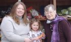 Charmaine and Anne-Marie Bain with Anne-Marie's daughter, Rose.