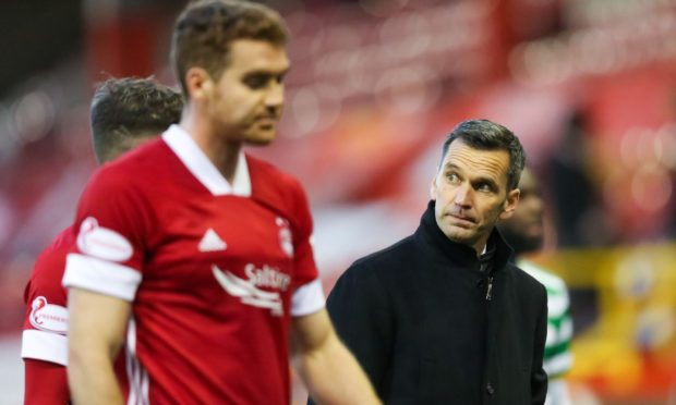 Tommie Hoban and Aberdeen manager Stephen Glass.