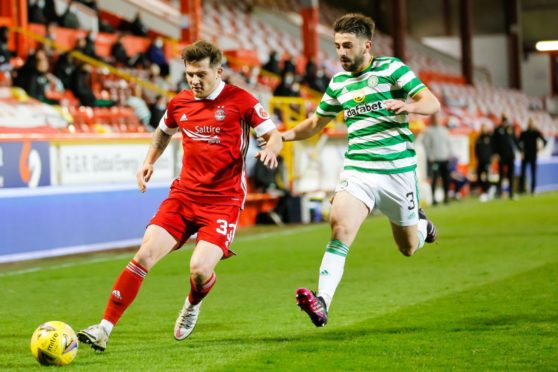 Aberdeen's Matty Kennedy and Greg Taylor of Celtic.