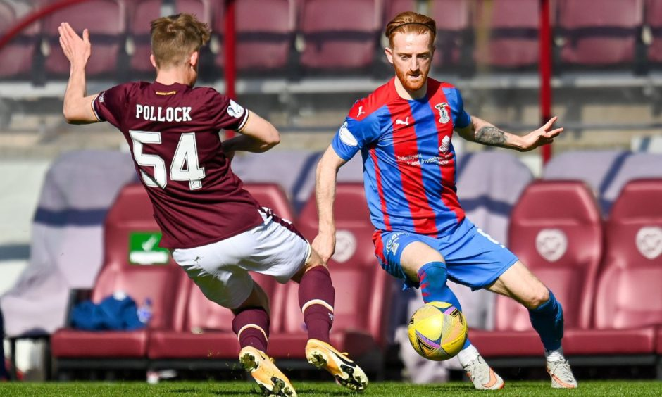 David Carson on the ball against Hearts at Tynecastle.