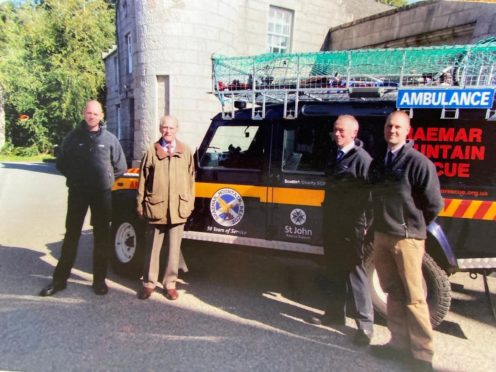 Prince Philip accepting the presentation of a new rescue vehicle with the Braemar Mountain Rescue team at Balmoral in 2014.