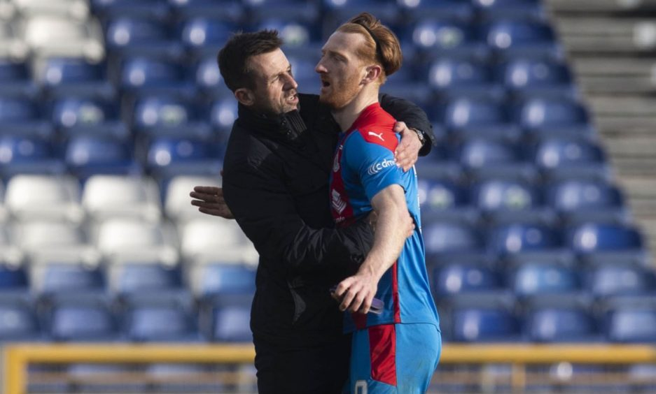David Carson is embraced by Caley Thistle interim manager Neil McCann.