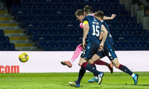Inverness' Shane Sutherland scores his side's third goal during a Scottish against Ross County in Friday's third round tie.