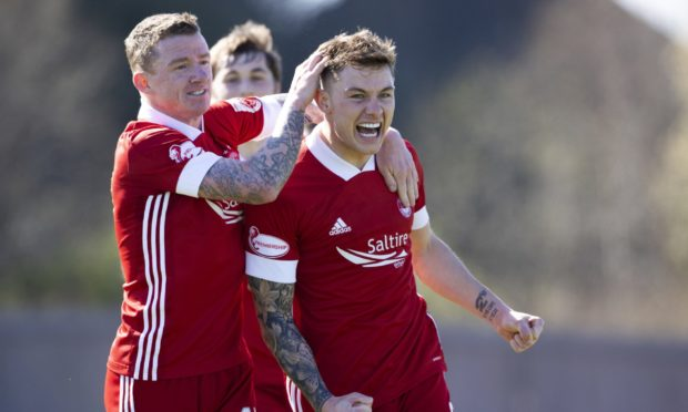 Aberdeen's Callum Hendry celebrates making it 1-0 against Dumbarton in the Scottish Cup.