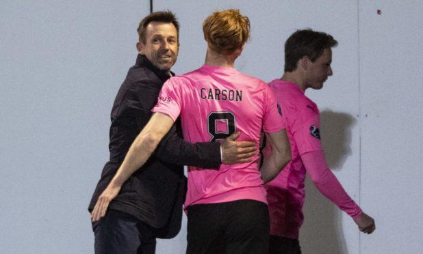 Interim Caley Thistle boss Neil McCann congratulates David Carson after their 4-1 win over Morton.