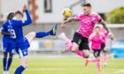 Queen of the South's  Rhys Breen (L) and Inverness' Miles Storey in action.
