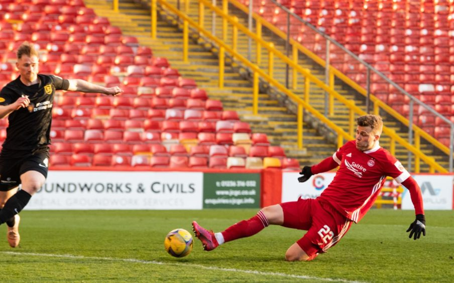 Florian Kamberi scores to make it 2-2 during a Scottish Cup tie between Aberdeen and Livingston.