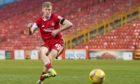 Ross McCrorie rolls home Aberdeen's winning penalty against Livingston.
