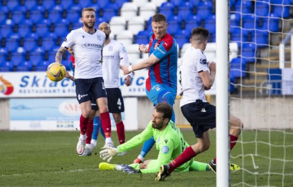 Inverness' Shane Sutherland (centre) in action against Dundee.