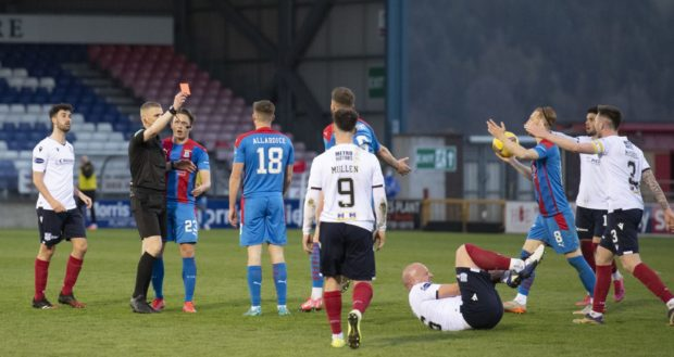 Inverness' Scott Allardice is sent off by referee Mike Roncone for a challenge on Charlie Adam.