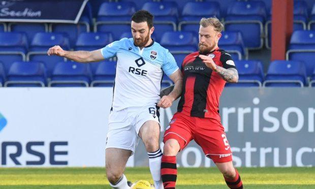 Ross Draper battles for possession against St Mirren.