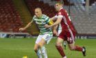 Celtic's Scott Brown (left) holds off Aberdeen's Dean Campbell.