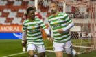 Celtic's Leigh Griffiths celebrates after he makes it 1-1 in stoppage time.