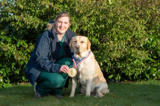 Baxter the hero Labrador with his owner Emma Tomlinson.
