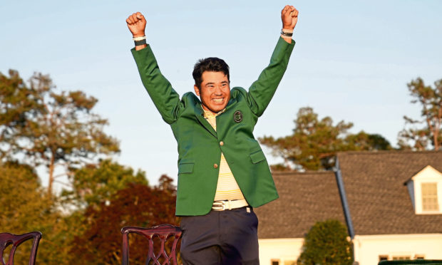 Masters champion Hideki Matsuyama of Japan celebrates wearing the Green Jacket.