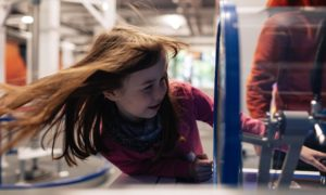 A visitor tests one of the exhibits at Aberdeen Science Centre.