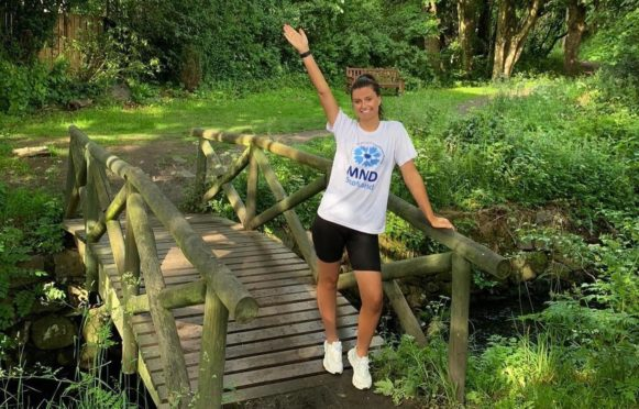 Abbie will run the marathon for MND Scotland and in support of cousin-in-law Martin Johnston.. Aberdeen. Supplied by MND Scotland