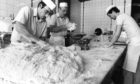 Adam Duguid, nightshift doughman, prepares the bread mixture while David Mair and Brian McIntosh prepare the rowie mixture at Chalmers' Bakery in Bucksburn in 1992.