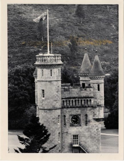 1979-08-28 The Queen's standard flying over the ramparts of Balmoral Castle. Photograph by Jim Love