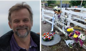 Chris Stuchbury's wife, Diane, has thanked those who supported her family after his death. Pictured: Floral tributes left at the Carmont signal box