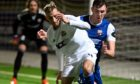Cove Rangers midfielder Connor Scully in action against Montrose.