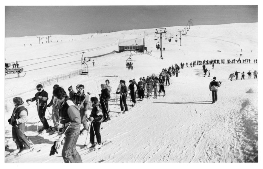 """19.03.1986 """"The queue for the chairlift stretches into the distance as the skiers patiently wait their turn to lifted to the top of the ski slopes at Cairnwell at the weekend."""" Photograph by Jim Love"""