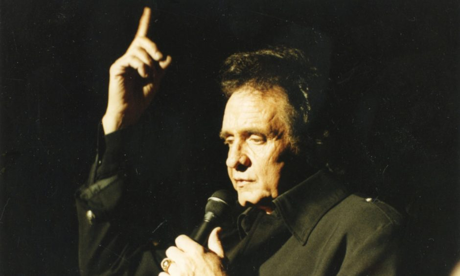 """Aberdeen Journals Library. Cash (Johnny) Capitol Cinema 1991-04-03 (C)AJL Used EE 03.04.1991 """"Johnny Cash: At the Capitol last night. Livin' up to being a living legend takes the guile and guts of a gunslinger, especially when up against Scotland's countriest of C&W fans..."""" Used EE 27.12.2017 the aberdonian Famous Bands and Musicians in Granite City"""