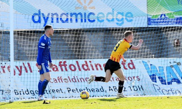 Andrew McDonald, left, is staying with Peterhead