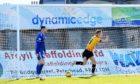 Scott Tiffoney, right, celebrates putting Partick Thistle 2-0 up against Peterhead