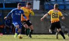 Kieran McGrath, left, in action for Peterhead against Partick Thistle.