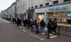 Eager shoppers queue outside Primark on Union Street ahead of its opening this morning. Picture by Kenny Elrick