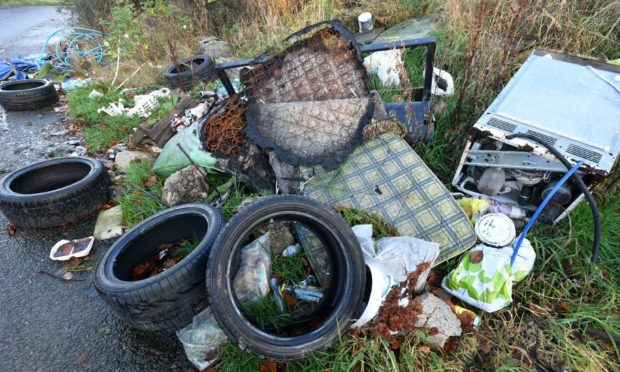 A mound of rubbish dumped on the outskirts of Elgin in July 2020.