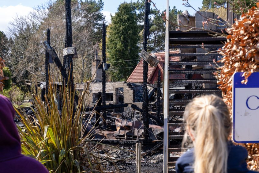 Only charred pillars and an external staircase are left of the Findhorn Foundation community centre.