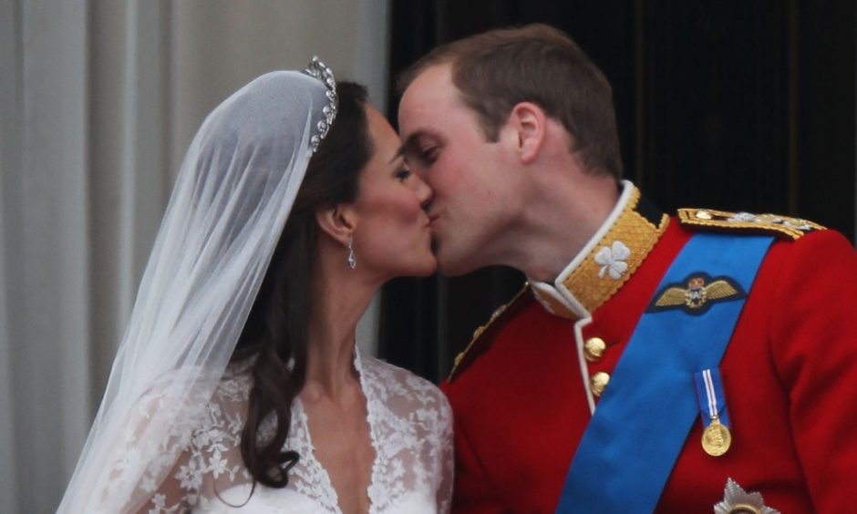 Their Royal Highnesses Prince William, Duke of Cambridge and Catherine, Duchess of Cambridge kiss on the balcony at Buckingham Palace following their marriage.