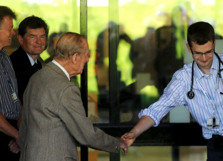 Prince Philip thanks hospital staff as he leaves Aberdeen Royal Infirmary at 11am in August 2012