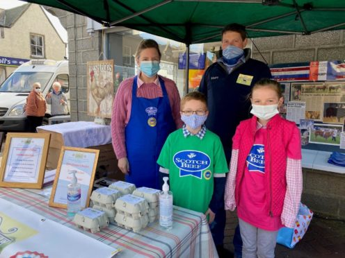Harry and Helen brown with their children Abbie and Murray at Ellon Farmer's Market.