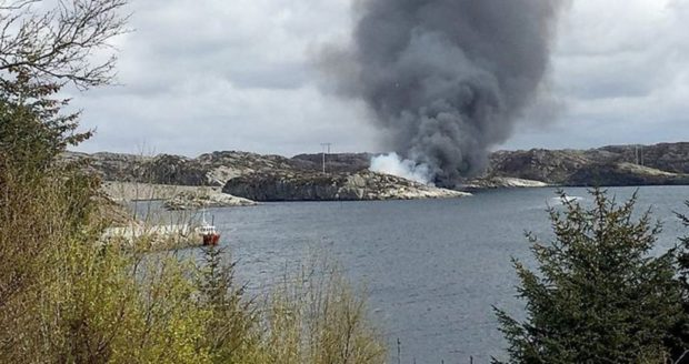 Smoke rising from the crash site of the CHC Super Puma HC225