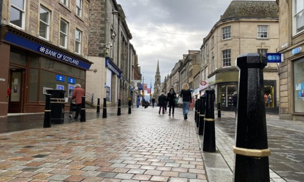Shoppers casually worked their way along Inverness High Street